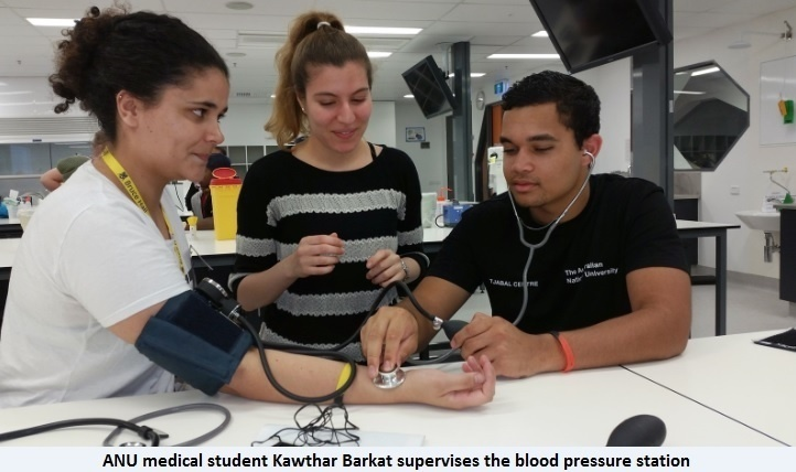 medical student at blood pressure station